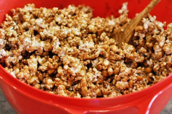 red bowl full of toffee coated popcorn