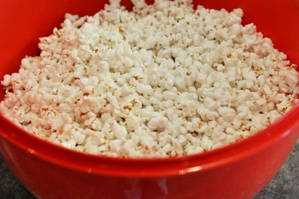 popped popcorn in a red bowl