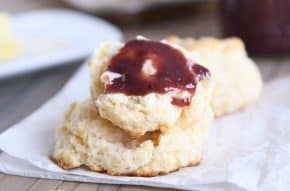 Easy flaky buttermilk drop biscuit with butter and jam.