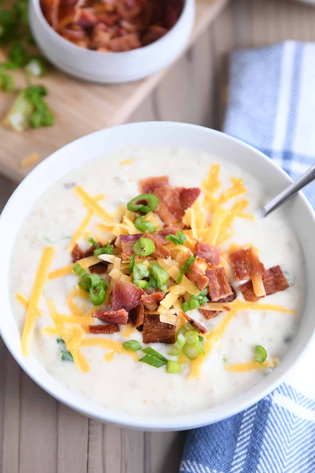 top down view of easy loaded baked potato soup in white bowl