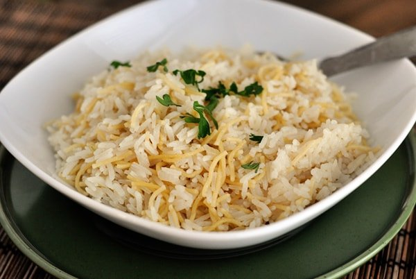 white bowl with cooked rice and pilaf