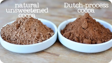 a white bowl of natural unsweetened cocoa next to a white bowl of dutch-process cocoa
