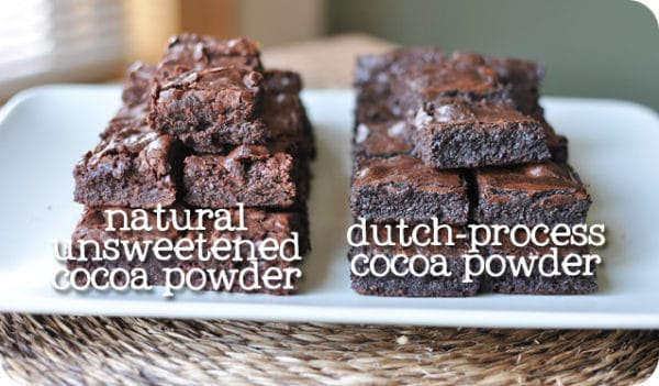 two stacks of brownies on a white platter, the left stack says natural unsweetened cocoa powder, and the right stack is darker and says dutch-process cocoa powder