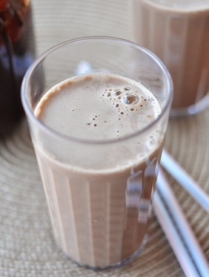 top view of a tall skinny glass of chocolate milk