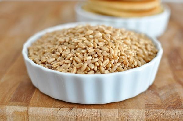 a white ramekin full of wheat berries