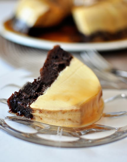 a piece of cake with a chocolate cake bottom and flan top on a glass plate