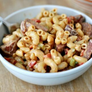 white bowl of barbecue macaroni salad with ham and elbow noodles