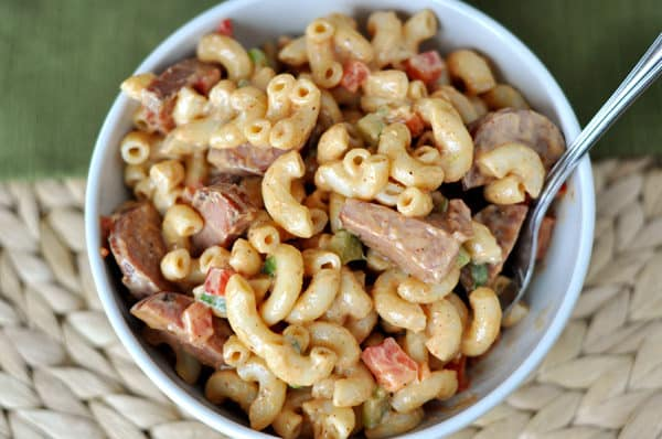 top view of a white bowl of macaroni salad with pieces of ham and elbow noodles