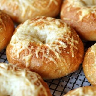 cheese-topped bagels on a cooling rack