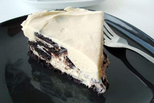 slice of no-bake oreo cheesecake on a black plate