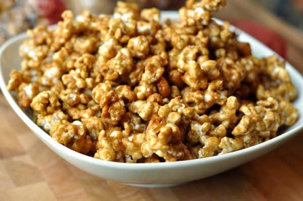 white bowl full of toffee popcorn