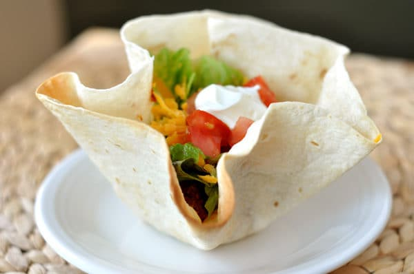 tortilla bowl filled with taco meat and toppings