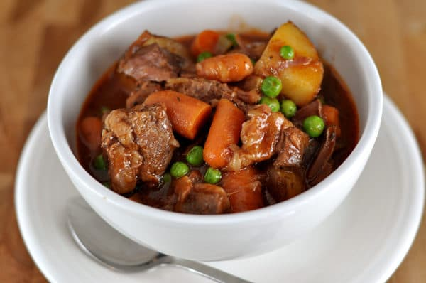 white bowl full of beef and vegetable stew