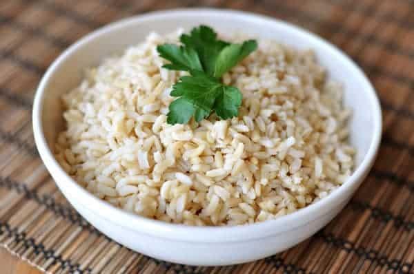 white bowl full of baked brown rice