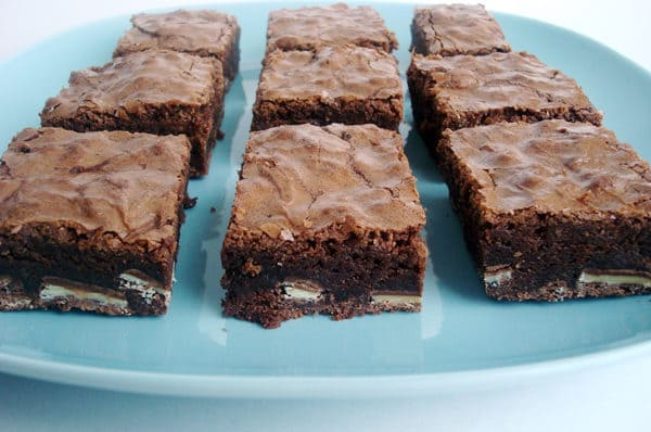 nine cut up mint brownies on a blue plate