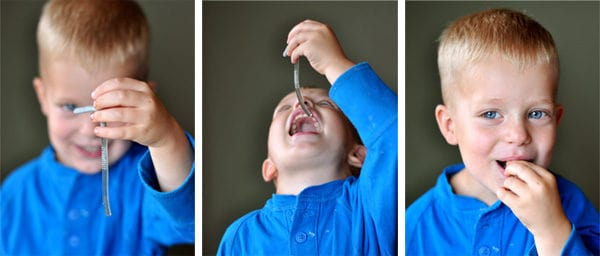 a little boy with 3 side-by-side shots eating a Jello worm