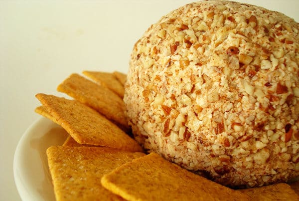cheeseball and crackers on a white plate