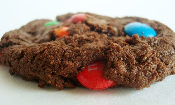 side view of a chocolate cookie sprinkled with m&m's