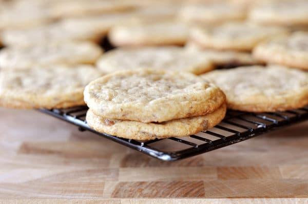 cookies on a dark cooling rack
