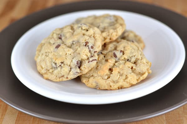 white plate with three chocolate chip cookies