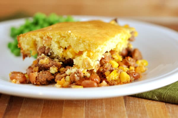 bean and corn cornbread-topped dinner on a white plate