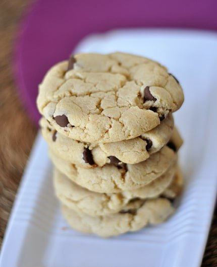 chocolate chip cookies stacked on top of each other on a white rectangular platter