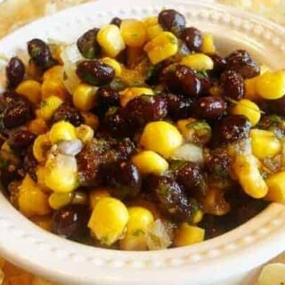 white bowl with corn and black bean salsa
