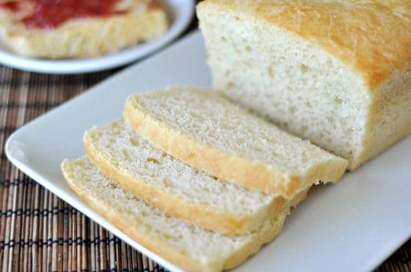 sliced white english muffin bread on a white platter