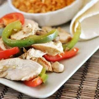 white platter with fajita chicken strips, and pepper strips