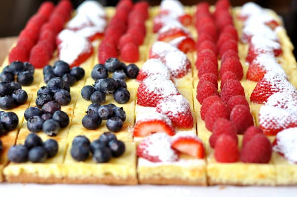 cheesecake squares decorated with berries to look like an American flag
