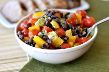 a white bowl with a black bean and veggie salad