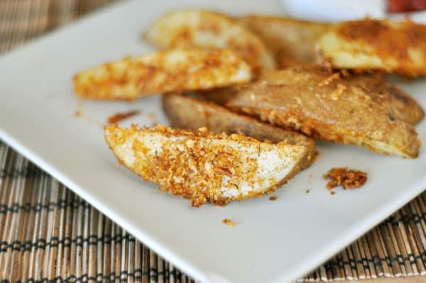 white rectangular platter with baked panko-crusted potato wedges