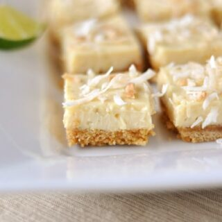 white platter with toasted coconut-topped key lime bars cut into small squares