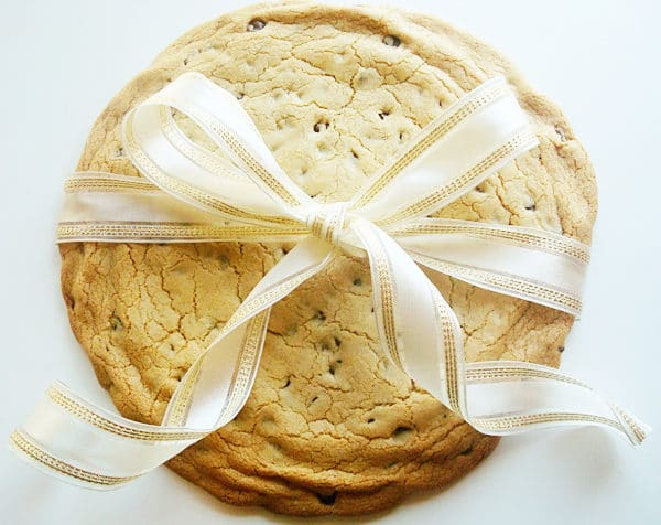 a giant chocolate chip cookie wrapped with a bow