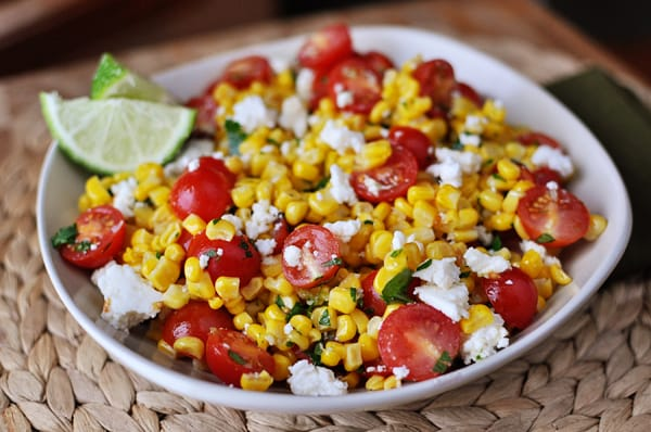 white bowl with top view of mexican tomato and corn salad