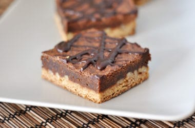 a white platter with chocolate congo bars with a chocolate drizzle on top