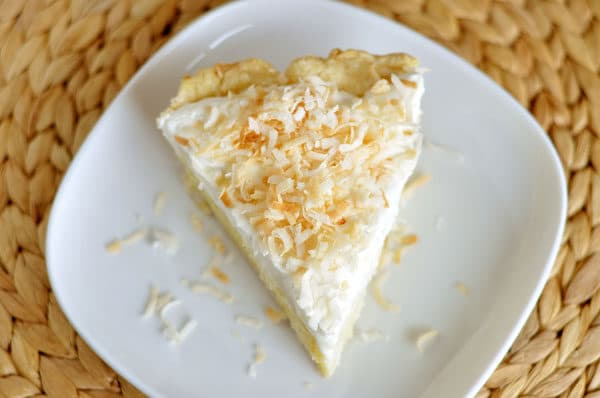 top view of a slice of coconut cream pie on a white plate