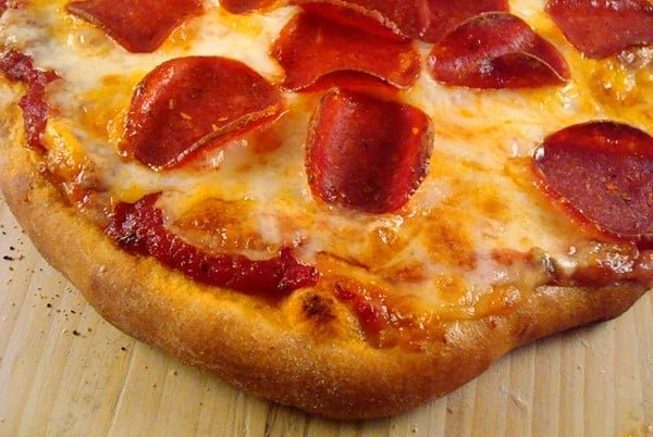 top view of a cooked pepperoni and cheese pizza