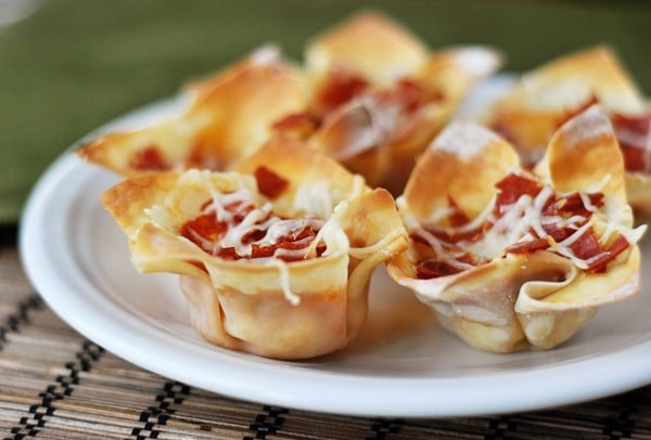 pizza appetizers cooked in wonton wrappers on a white plate