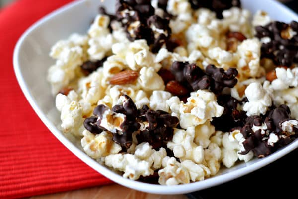 a white bowl full of chocolate-dipped kettle corn