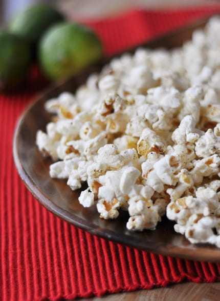 spice-topped popped popcorn on a brown plate