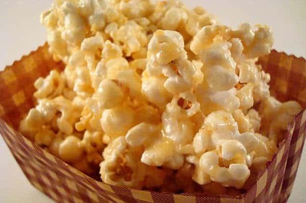 caramel popcorn in a brown basket
