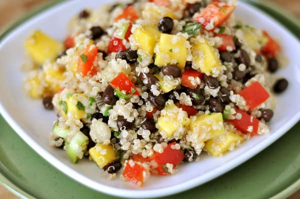 white plate with mango and quinoa black bean salad