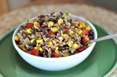 white bowl with rice, bean, corn, and pepper salad