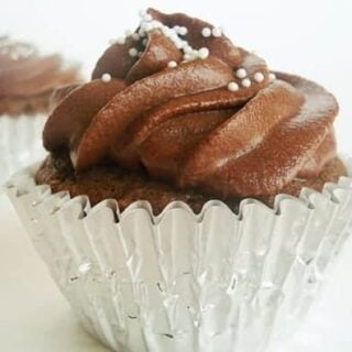 chocolate frosted cupcake in a silver muffin liner