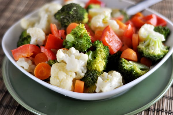 sautéed peppers, carrots, broccoli, and cauliflower in a white dish