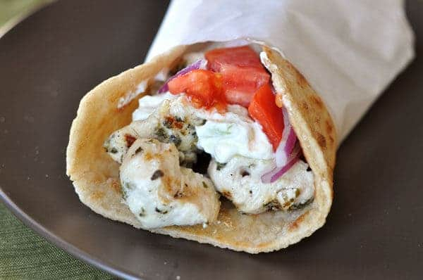 wrapped chicken gyro on a black blate