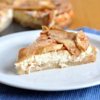 a slice of apple torte on a white plate