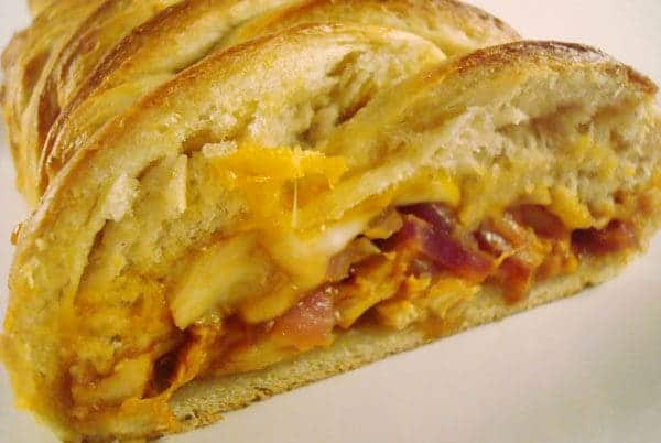 braided bread loaf cut open filled with chicken and cheese