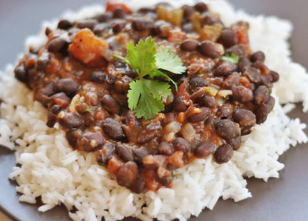 white rice topped with black bean and tomato mixture